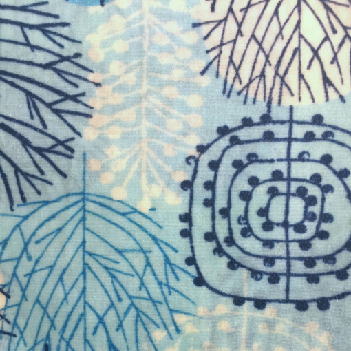 Light blue patterned fabric with geometric twigs and patterns