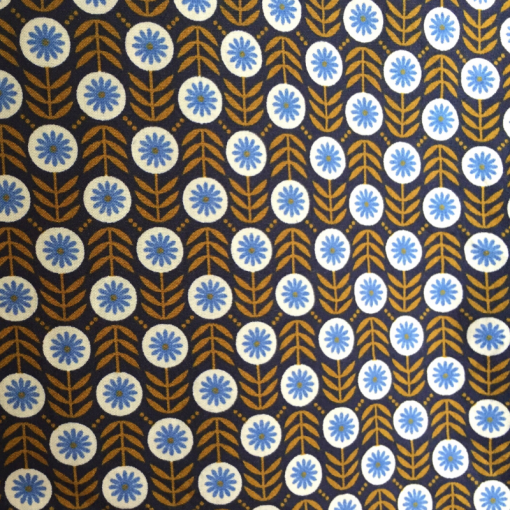 Patterned fabric brown leaves with blue flowers in little circles