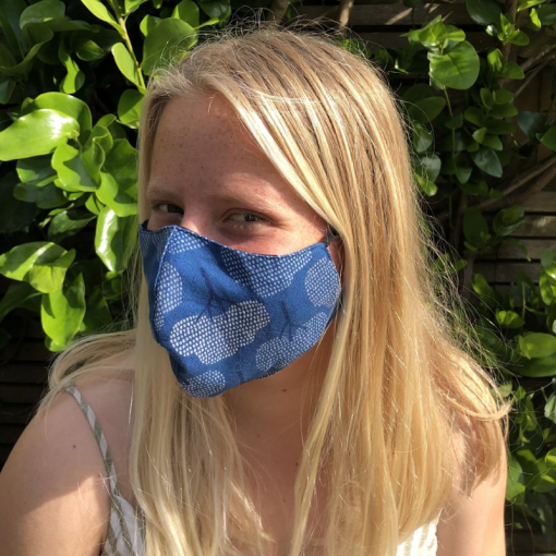 Teenager modelling blue tree face mask available for sale at Goagain