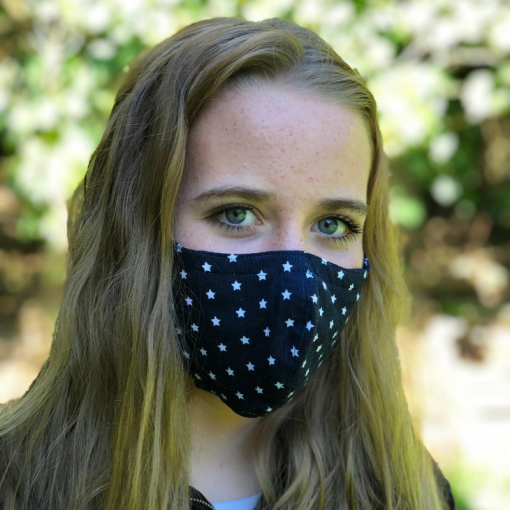 Head shot of teenager wearing navy blue mask with white stars